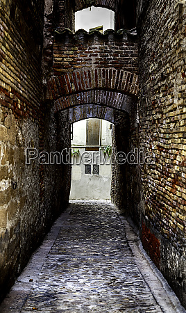 old medieval alley in an old