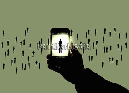 businessman on smart phone screen standing