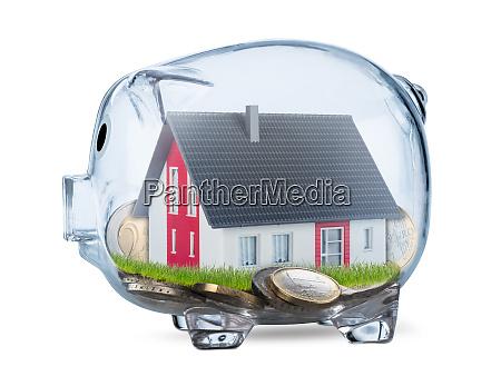 concepto inmobiliario de alcancia transparente