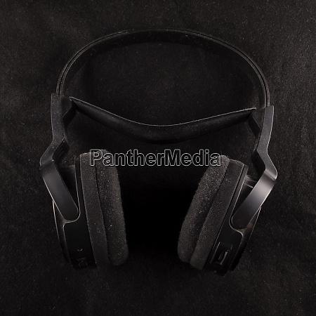 black headphones over black background