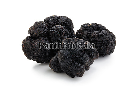 black truffles on white