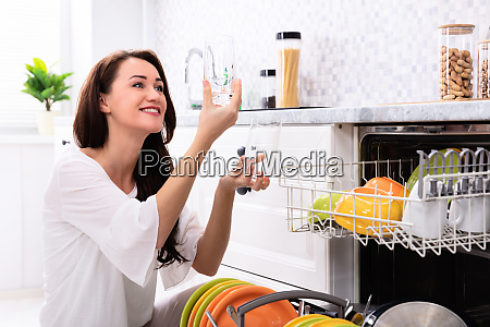 happy woman looking at drinking glasses