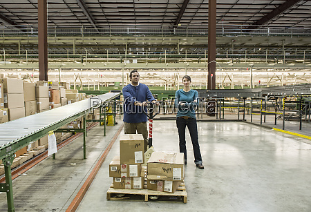 caucasian male and female workers in