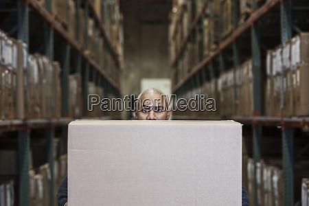 a black warehouse worker hidden behind
