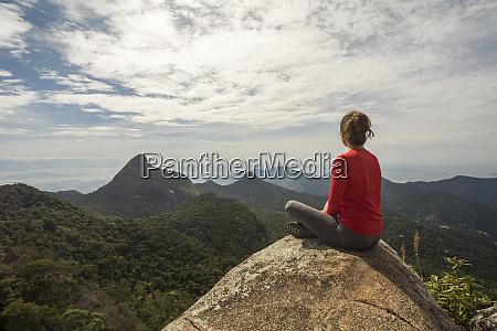rear view of single woman sitting