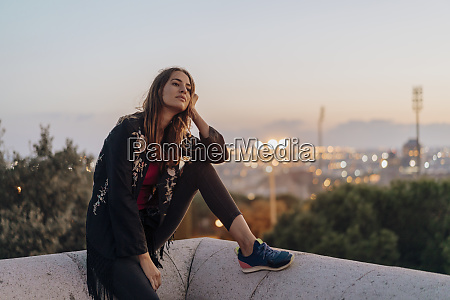 spain barcelona montjuic young woman sitting