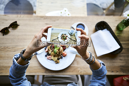 overhead view of woman taking smartphone