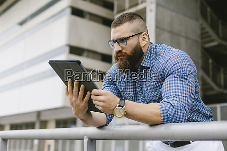 bearded hipster businessman wearing glasses wrist