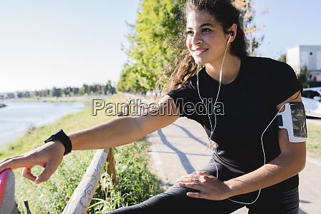 sportive young woman stretching her leg