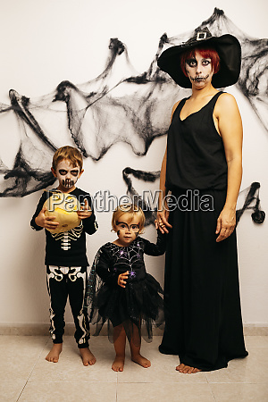 mother and her two children dressed