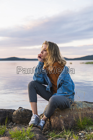 finland lapland young woman sitting on