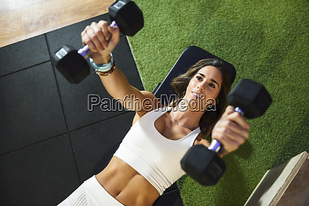 woman training with dumbbells in a