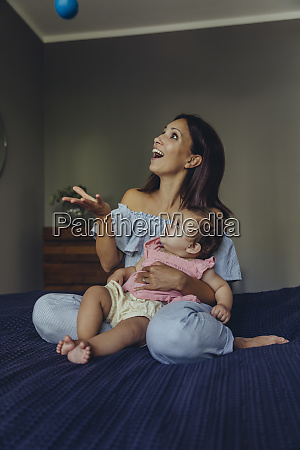 happy mother playing with her baby