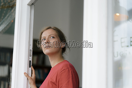 young woman at french door in