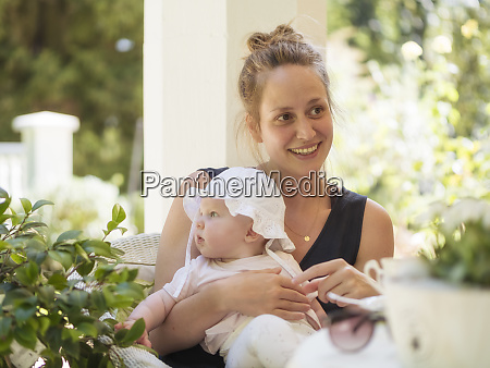 portrait of relaxed mother with baby