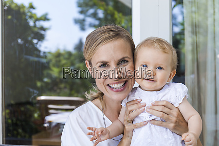 portrait of happy mother holding her