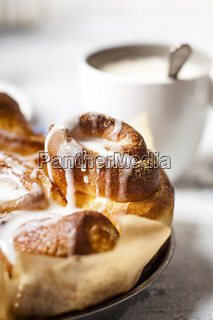 home baked cinnamon buns with icing