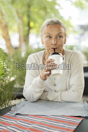 senior woman with a drink at