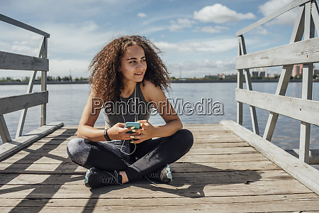 young athletic woman sitting at the