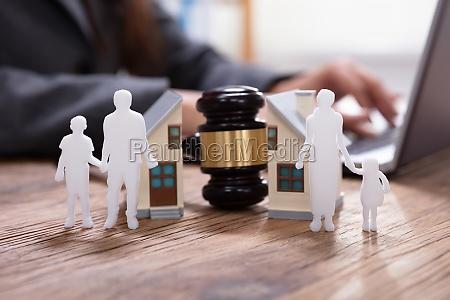 gavel between split family figures and