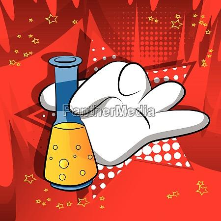 cartoon hand holding a test tube