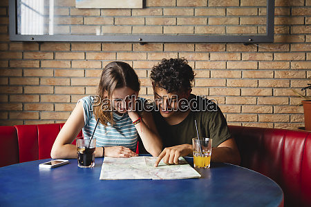 smiling young couple sitting at table