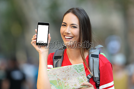 teen tourist showing a mobile phone