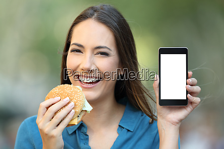 woman holding a hamburger showing a