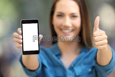 positive woman showing a blank smart