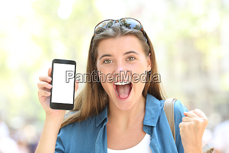 excited woman showing a smart phone
