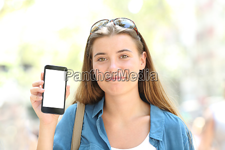 satisfied girl showing a blank phone