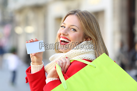 shopper showing credit card in winter
