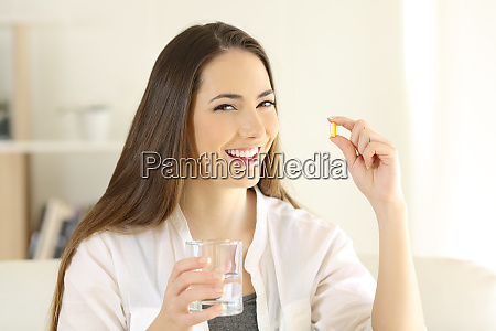 happy lady holding and showing a