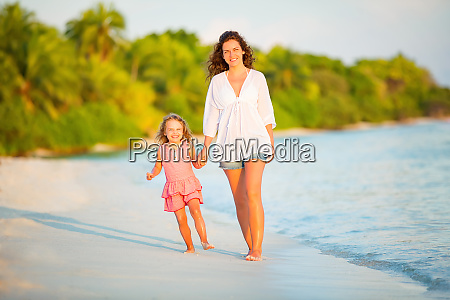 mother and little daughter walking on