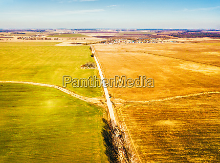 spring green and brown agricultural fields