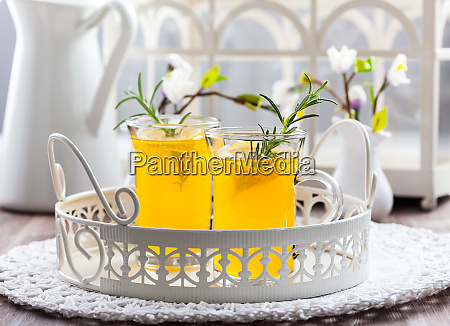 fresh lemon drink with rosemary in