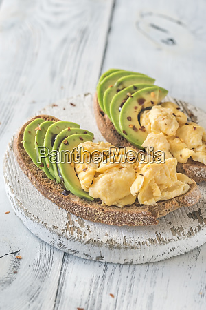 sandwiches with avocado and scrambled eggs