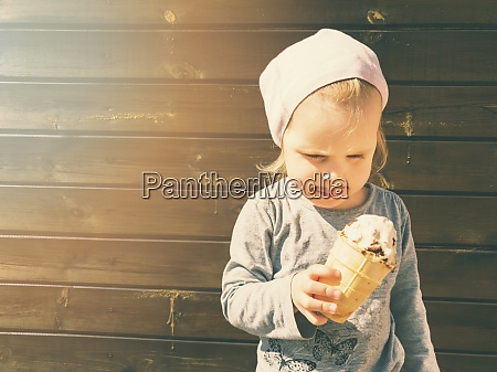 child with ice cream in hand