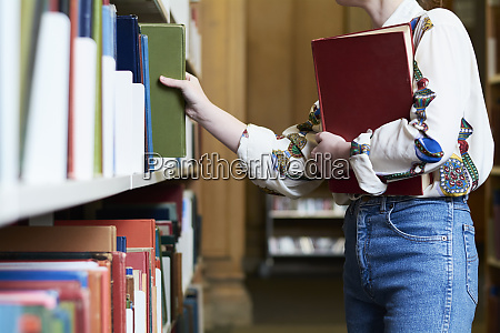 female student with a book in