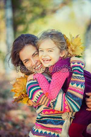 mother and daughter enjoy sunny autumn