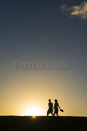 tourists in backlight walking to the