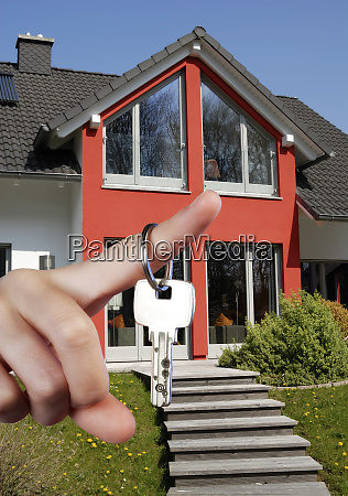 hand with key and house
