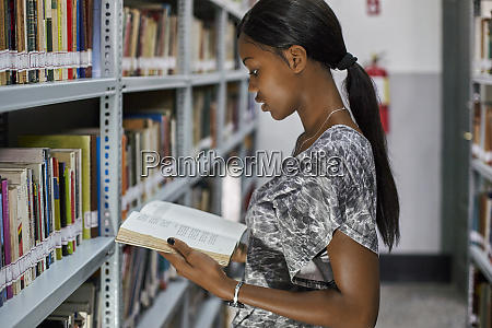 young woman checking a book at