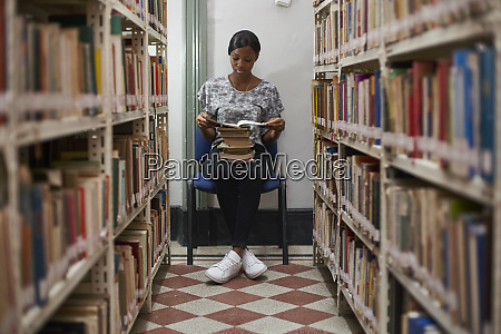 young woman reading a book at