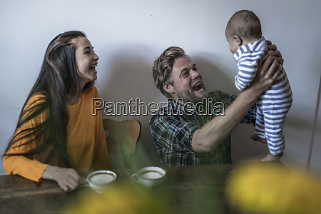 happy family with baby sitting at