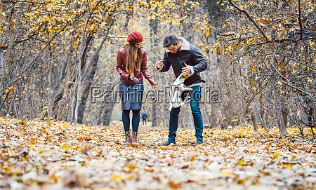 woman and man petting the dog