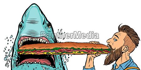 tiburon y el hombre comiendo sandwiches