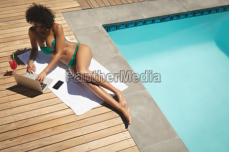 young african american woman using laptop