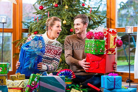 man and woman sitting with presents