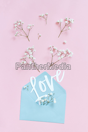 flowers envelope and word love on